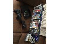 PlayStation two games to controllers good condition