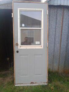 gray enter steel door with casing