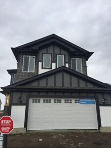 HOUSE BACKING POND IN STONY PLAIN $489,900