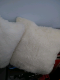 2 brand new white fluffy pillows