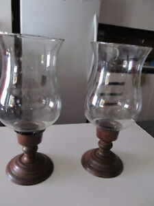 Set of 2 brass and glass hurricanes candle holders.