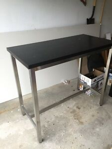 Bar height table, bar stools and a tv stand