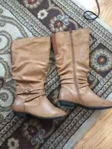 Brand new knee high never worn boots