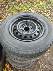 4 Winter tires with rims and valve
