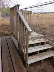 Small deck complete with stairs and rails