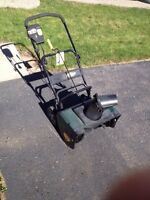 Electric snow thrower.