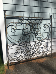 Scrolled wrought iron divider