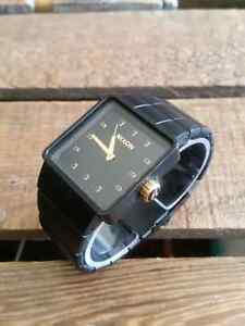 Men's matte black and gold Nixon 'QUATRO' watch $95 OBO.