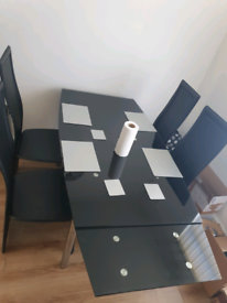 Glass black table with 4 chairs