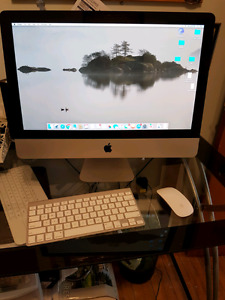 "2011 iMac 21.5"" screen, 2.7 ghz, 4gb ram, 1tb storage"