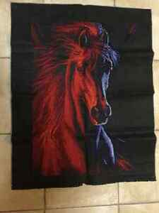 Embroidered picture of a strong brave horse