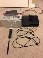 320 GB PS3 with 2 controllers 13 games, and PlayStation move
