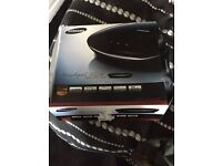 BOXED DVD PLAYER WITH INSTRUCTIONS AND REMOTE