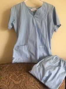 30 size small and xsmall scrub tops and 6 pairs of pants.