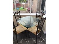 Glass topped table with 4 chairs