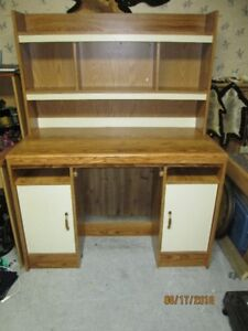 Medium sized wooden desk with top shelves.