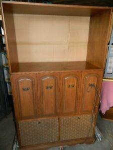 AN OLD RETRO RADIO AND RECORD PLAYER CABINET