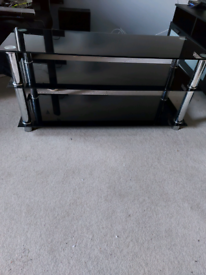 Long black glass TV stand