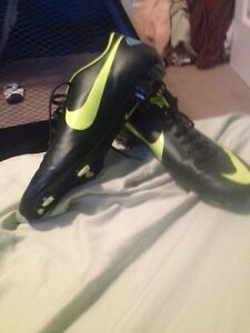 Black and yellow mercurial cleats