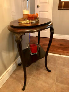 Double faced solid walnut two tier hand crafted and carved table