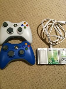 Two Xbox 360 controllers and charging station