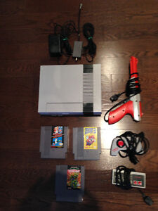 Original NES with 2 controllers, 3 games and Orange Zapper