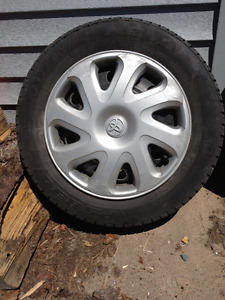 Four 175 65 R14 All-Season Tires with steel rims and hubcaps