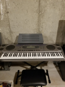 Piano Keyboard with stand and stool for sale