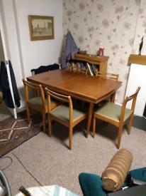60 retro Danish teak extending table and 6 original chair's