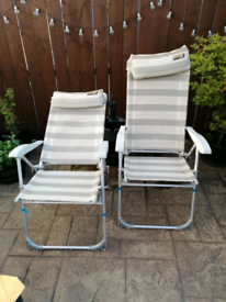 Two summer recliner garden lounger chairs and bag