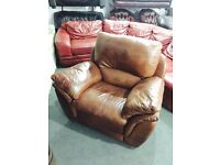 As new tan leather recliner armchair