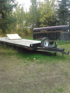 2 flat bed trailers