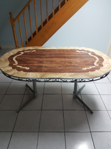 1970s vintage table with leaf extension.