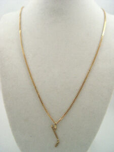 Solid 10K Gold 20 inch Chain and Hockey Pendant