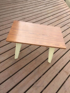 Side table with cream colored legs