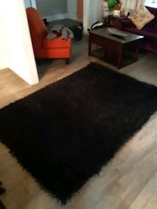 Black area rug 5' x 7'
