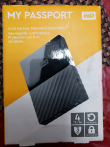 WD 4TB terabyte portable drive with plastic still on