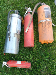 Set of 4 antique fire extinguishers