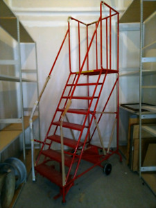 8 step bright red Staples rolling warehouse ladder