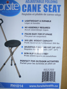 cane doubles as chair-new in box