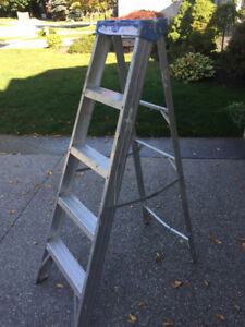 5 foot tall aluminum step ladder - priced to move