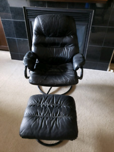 Leather chair and footstool.