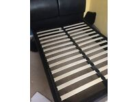 Double bed, ottoman style in black faux leather