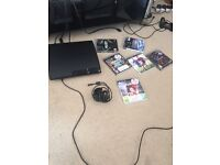 Play Station 3 with six games and camera for sale.
