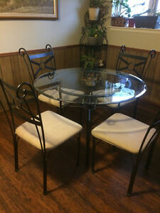 Dining set ( Glass table and four chairs)