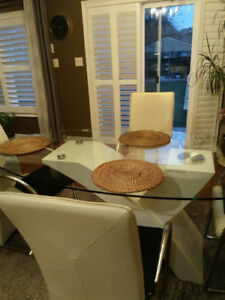 Glass dining room table set with 6 chairs