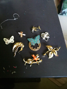 Vintage gold and silver brooches.