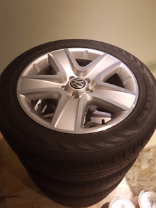 VW Tiguan OEM rims and Continental tires 235/50r18 95% THREAD