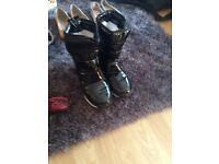 Pair of ladies snow boots and reebok gym trainers