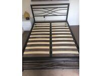 Black metal double framed bed